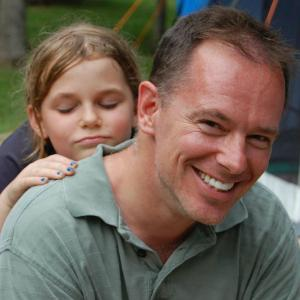 Larry Gillick -- with his daughter resting on his shoulder.